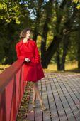 Woman at autumn park and pink boundaries — Stock Photo