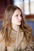 Woman in beige coat with suprise look — Stock Photo
