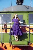 Woman in lilac dress at train front — Zdjęcie stockowe