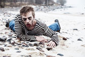 Seaside zombie hunting — Stock Photo