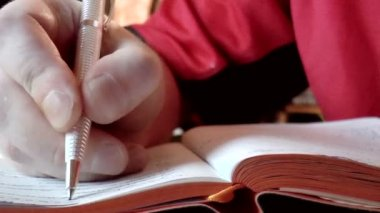 Closeup hands writing in diary — Stock Video