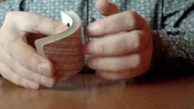 Two hands shuffling a deck of cards — Stock Video