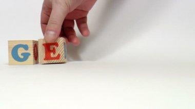 Wooden cubes. German — Stock Video