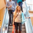 Female Shopper On Escalator In Shopping Mall — Stock Photo #59343671