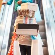 Woman Carrying Boxes And Bags In Shopping Mall — Stock Photo #59344085