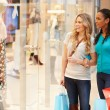 Two Female Friends Window Shopping With Bags — Stock Photo #59344093