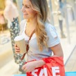 Female Shopper With Takeaway Coffee In Mall — Stock Photo #59344135