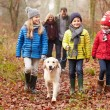Family Walking Dog Through  Forest — Stock Photo #59344791