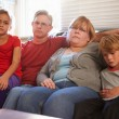 Unhappy Family Sitting On Sofa — Stock Photo #59345067
