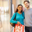 Portrait Of Couple Carrying Bags In Shopping Mall — Stock Photo #59345331