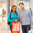 Portrait Of Couple Carrying Bags In Shopping Mall — Stock Photo #59346021