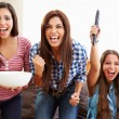 Group Of Women Sitting On Sofa Watching Sport Together — Stock Photo #59346237