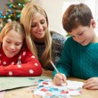 Mother And Children Writing Letter To Santa — Stock Photo #59346245