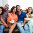 Group Of Friends Sitting On Sofa Watching TV Together — Stock Photo #59346321