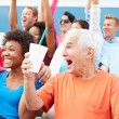 Spectators Cheering At Outdoor Sports Event — Stock Photo #59346419