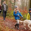 Family Walking Dog Through  Forest — Stock Photo #59346421