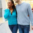 Portrait Of Couple Carrying Bags In Shopping Mall — Stock Photo #59346531