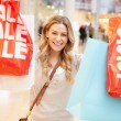 Excited Female Shopper With Sale Bags In Mall — Stock Photo #59347017