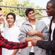 Young Men Greeting One Another — Stock Photo #59347189