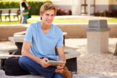 Male Student Using Digital Tablet — Stock Photo