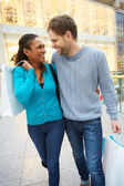 Happy Couple Carrying Bags In Shopping Mall — Stock Photo