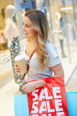Female Shopper With Takeaway Coffee In Mall — Stock Photo