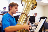 Male Pupil Playing Tuba — Stock Photo