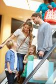 Family On Escalator In Shopping Mall Together — Stock Photo