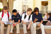 Male Students Using Mobile Phones — Stock Photo