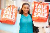 Excited Female Shopper With Sale Bags In Mall — Foto de Stock