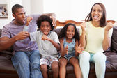 Family Sitting On Sofa Watching TV Together — Stock Photo