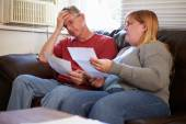 Worried Couple Looking At Bills — Stock Photo