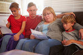 Unhappy Family  Looking At Bills — Stock Photo