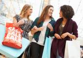 Excited Female Shoppers With Sale Bags In Mall — Stock Photo