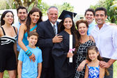 Hispanic Student And Family Celebrating Graduation — Stock Photo