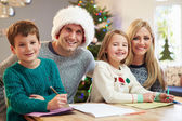 Family Writing Christmas Cards Together — Stock Photo