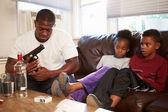 Father Checks Gun — Stock Photo