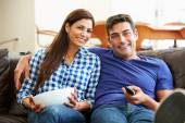 Couple Sitting On Sofa Watching TV Together — Stock Photo