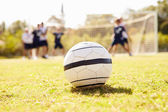 Soccer Ball With Players In Background — Stock Photo