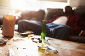 Man Slumped On Sofa With Drug Paraphernalia In Foreground — Stock Photo