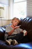 Boy with  Pack Of Cigarettes — Stock Photo