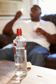 Man With  Vodka And Cigarettes — Stock Photo