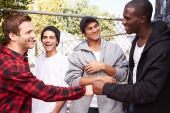 Young Men Greeting One Another — Stock Photo