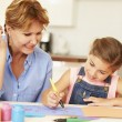 Grandmother Painting With Granddaughter — Stock Photo #59873465