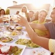People Enjoying Outdoor Summer Meal — Stock Photo #59873969