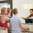 Family Checking In At Hotel — Stock Photo #59874527
