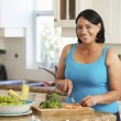 Overweight Woman In Kitchen — Stock Photo #59874913