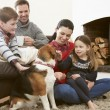 Family  Stroking Dog — Stock Photo #59874925