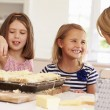 Girls With Mother Making  Toast — Stock Photo #59875343