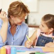 Grandmother Painting With Granddaughter — Stock Photo #59875409